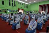 LPMI Taruna Karya Palembang gelar  vaksinasi massal di permukiman