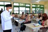 Wapres tinjau pelaksanaan PTM terbatas dan vaksinasi di Banten