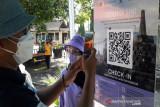 Simulasi pembukaan Borobudur dengan aplikasi peduli lindungi