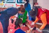 PON Papua - Masker menjadi syarat layanan kesehatan posko medis arena Panjat Tebing