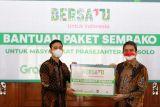 Dukung penanganan pandemi di Surakarta, Grab salurkan paket sembako