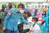 Melihat Serbuan Vaksin Maritim di pulau terluar di Riau