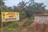 Polisi pasang peringatan bahaya buaya di Desa Talang Kerinci