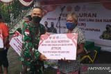 Kodim 1701/Jayapura salurkan bantuan tunai PKL-warung