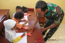 Membangun kembali desa transmigrasi di Aceh