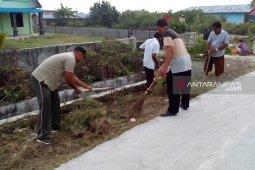 Koramil 09/TM bersama masyarakat laksanakan gotong royong