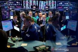 Wall Street turun tajam, meskipun Fed pangkas suku bunga darurat