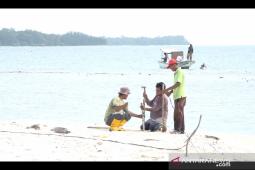 Workers begin construction of helipad on Sebaru Island