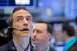 Pemangkasan suku bunga Fed melindungi ekonomi, reaksi investor beragam