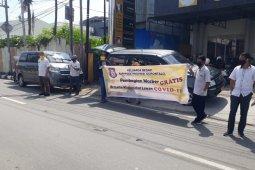 Bappeda Gorontalo bagikan masker ke pengguna jalan