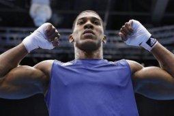"Juara dunia tinju Anthony Joshua sebut demonstran itu ""vaksin"" bagi ""virus"" rasisme"