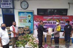 PWI Simalungun salurkan paket sembako bantuan Polres Simalungun kepada anggota