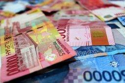 Rupiah ditutup positif pada akhir pekan seiring dengan kembalinya optimisme pasar