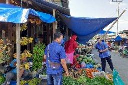 BRI Aceh bagikan masker untuk pedagang pasar