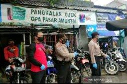 Kepolisian bantu kondisikan new normal