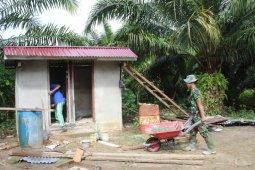 TMMD juga rehab toilet Mushola At Taqwa Desa Beringin Rayo