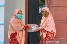 DWP DPMD serahkan bantuan masker ke DWP Lutim