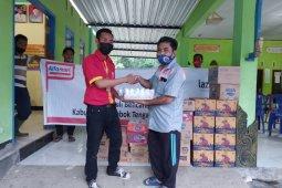 Uang Receh Konsumen untuk Korban Banjir Lombok