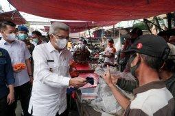 Pemprov Sumsel kembali bagikan ribuan  masker tekan kasus positif COVID
