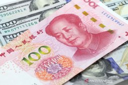 Yuan   menguat 124 basis poin