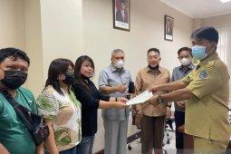 Warga GPI Adukan Soal Jalan Rusak ke DPRD Sulut
