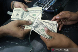 Dolar AS naik tipis karena selera risiko memburuk