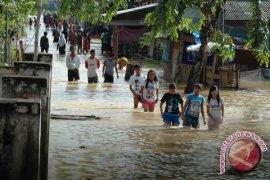 Wartawan bantu korban banjir Padang