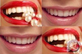 Cara alami memutihkan gigi dengan kunyit