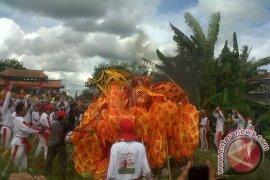Ritual Naga Tutup Mata dan Pembakaran
