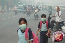 Kadisdik tidak menyetujui sekolah diliburkan karena asap
