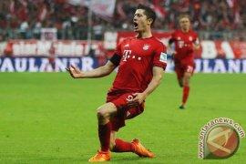 Lewandowski bawa Muenchen berada diambang 16 besar