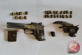 Two Sand Miners Found Firearms