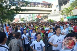 Agus Prayogo Raih Juara 10 K Depok