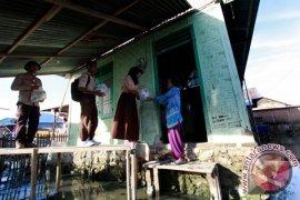 Pramuka Salurkan Bantuan Korban Banjir Gorontalo