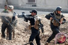 Pasukan Irak serbu pangkalan milisi  yang didukung Iran