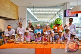 Cheerful Expression of Junior Chef during Kids Cooking Class at HARRIS-POP! Hotels & Conventions Denpasar