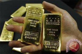 Emas berjangka sedikit lebih tinggi jelang pertemuan Federal Reserve
