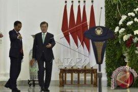 Hujan Warnai Kedatangan Presiden Korea Selatan