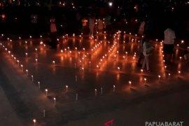 Aksi seribu lilin mengenang duka banjir bandang Wasior