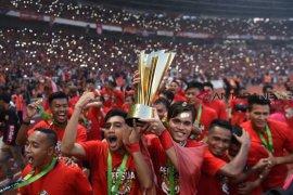 Pemain Persija Jakarta rayakan memori juara Liga 1 Indonesia 2018