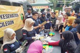 Biddokes Polda Banten Berikan Layanan Kesehatan Gratis
