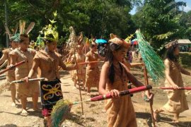 Upau residents perform Dayak Deah Culture