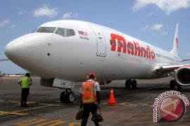 Pesawat Malindo Air keluar dari landas pacu di Bandara Bandung