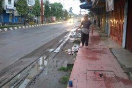 Jalan Kota Stabat becek dan kumuh