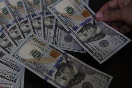 Dolar AS tergelincir, permintaan mata uang aman tertekan