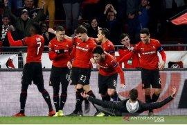 Rennes hantam 10 pemain Arsenal 3-1