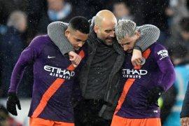 Guardiola: Manchester City wajib menang tujuh laga tersisa