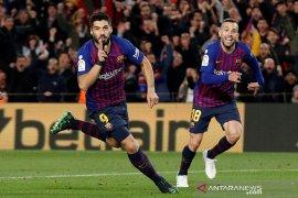 Barcelona membungkam 10 pemain Atletico