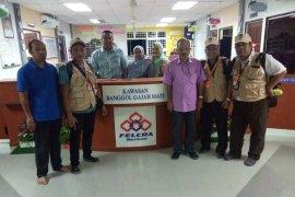 WNI pekerja sawit di Malaysia mulai mencoblos.