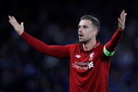Pelatih Liverpool  meminta maaf kepada Henderson meskipun menang atas Porto